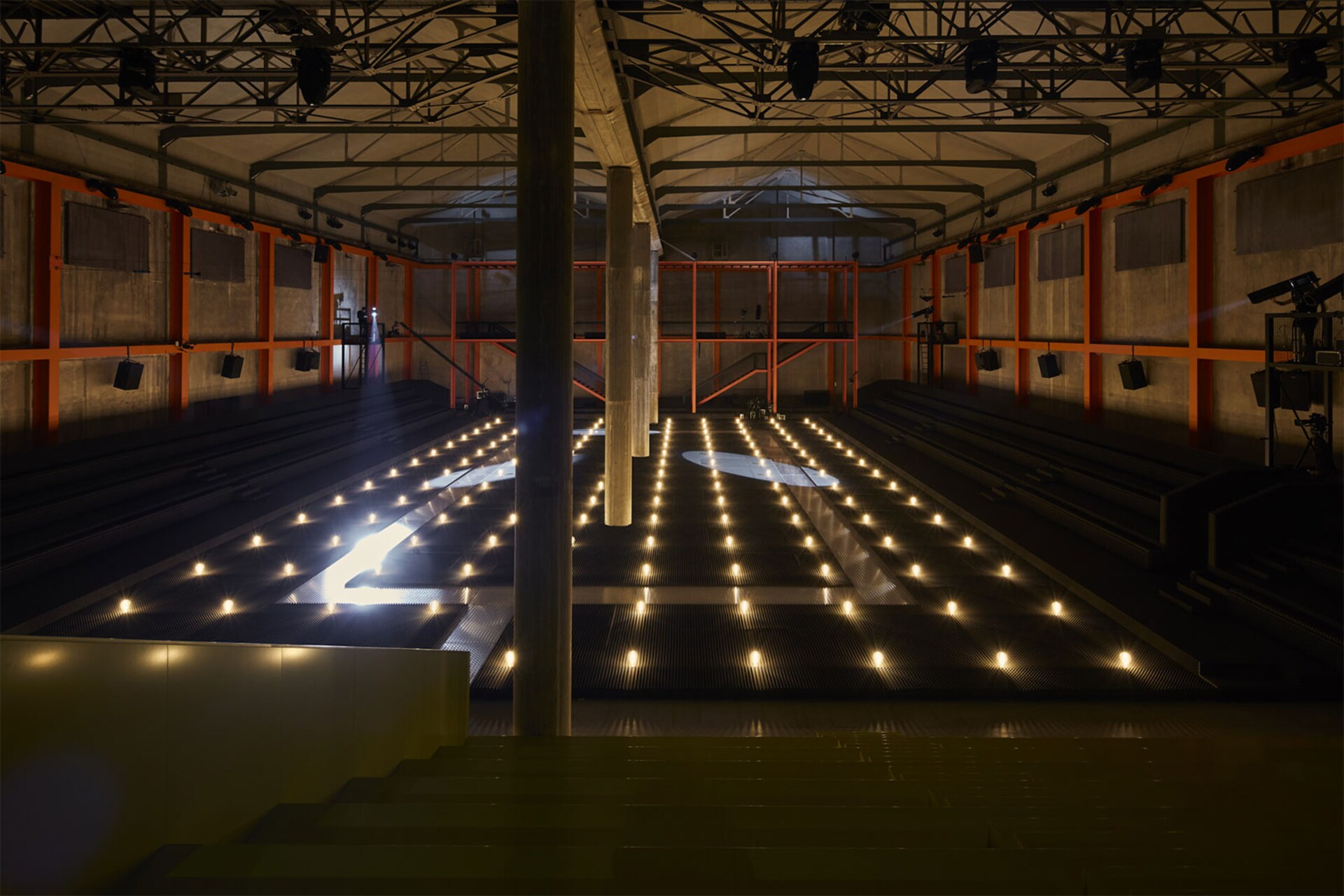 Prada Fall Winter 2019 Men's and Women's fashion show space detail 5 For the 2019 Fall/Winter Prada shows – both Men's and Women's, AMO has created a theatrical field of lights in the grand hall of the Deposito, the multifunctional venue for performances that is part of the Fondazione Prada complex.
