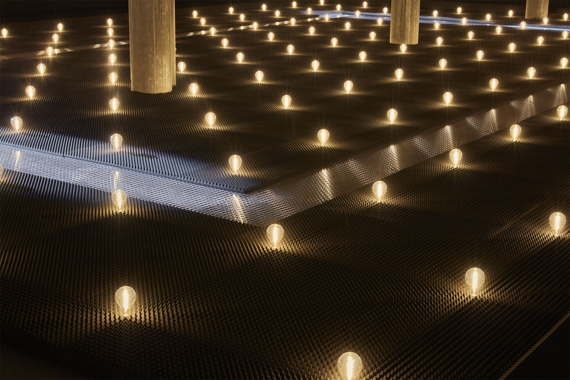 Prada Fall Winter 2019 Men's and Women's fashion show space detail 8 For the 2019 Fall/Winter Prada shows – both Men's and Women's, AMO has created a theatrical field of lights in the grand hall of the Deposito, the multifunctional venue for performances that is part of the Fondazione Prada complex.