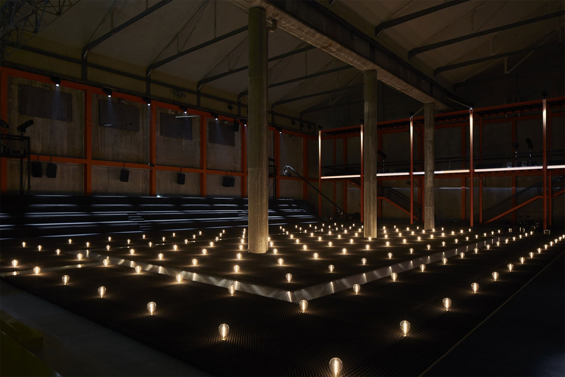 Prada Fall Winter 2019 Men's and Women's fashion show space detail 10 For the 2019 Fall/Winter Prada shows – both Men's and Women's, AMO has created a theatrical field of lights in the grand hall of the Deposito, the multifunctional venue for performances that is part of the Fondazione Prada complex.