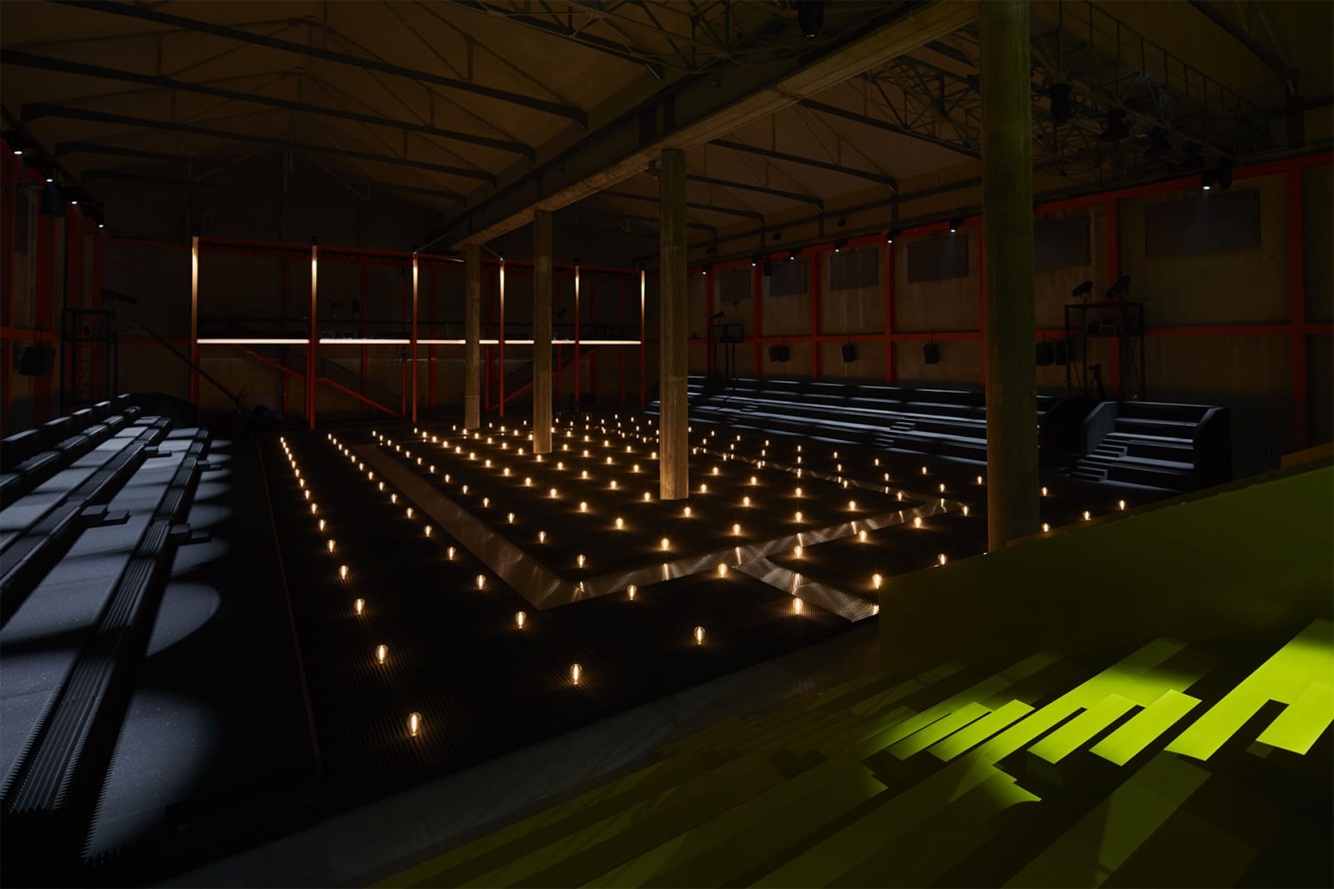 Prada Fall Winter 2019 Men's and Women's fashion show space detail 12 For the 2019 Fall/Winter Prada shows – both Men's and Women's, AMO has created a theatrical field of lights in the grand hall of the Deposito, the multifunctional venue for performances that is part of the Fondazione Prada complex.