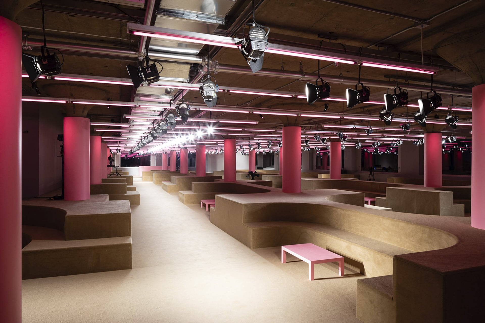 Prada Resort 2020 fashion show space 7. For the Prada 2020 Resort Show, AMO takes over the Piano Factory, Prada US's headquarters, and reinterprets it as an intimate setting for social gathering.