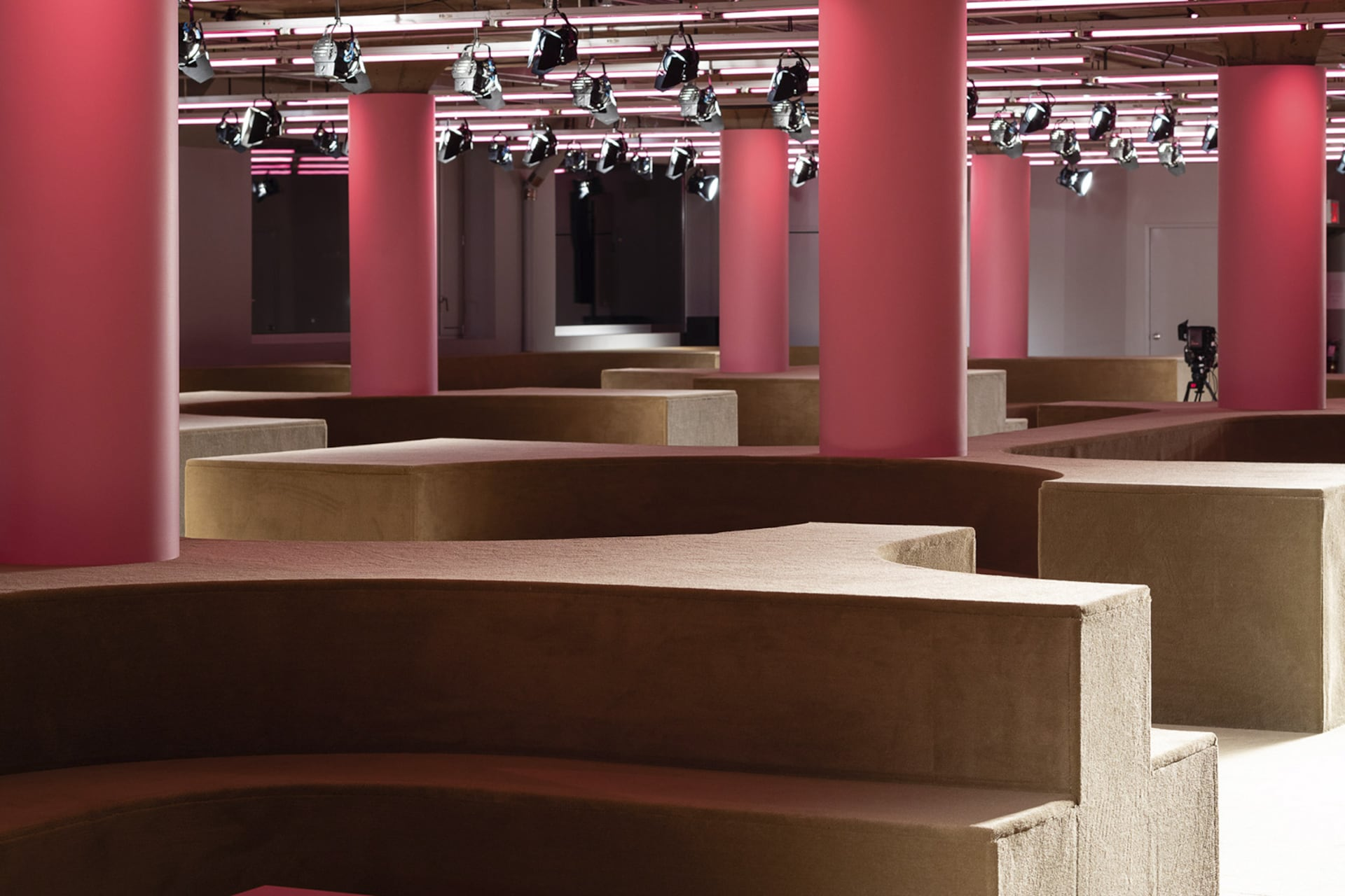 Prada Resort 2020 fashion show space 8. For the Prada 2020 Resort Show, AMO takes over the Piano Factory, Prada US's headquarters, and reinterprets it as an intimate setting for social gathering.