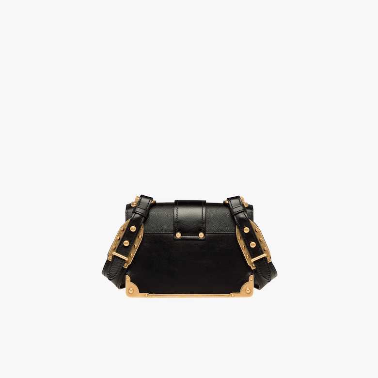 eb50d5a8cd92 Inspired by valuable ancient books, the Prada Cahier bag, here in a  two-tone version, is made of soft calf leather. The metal hardware gives it  an ...