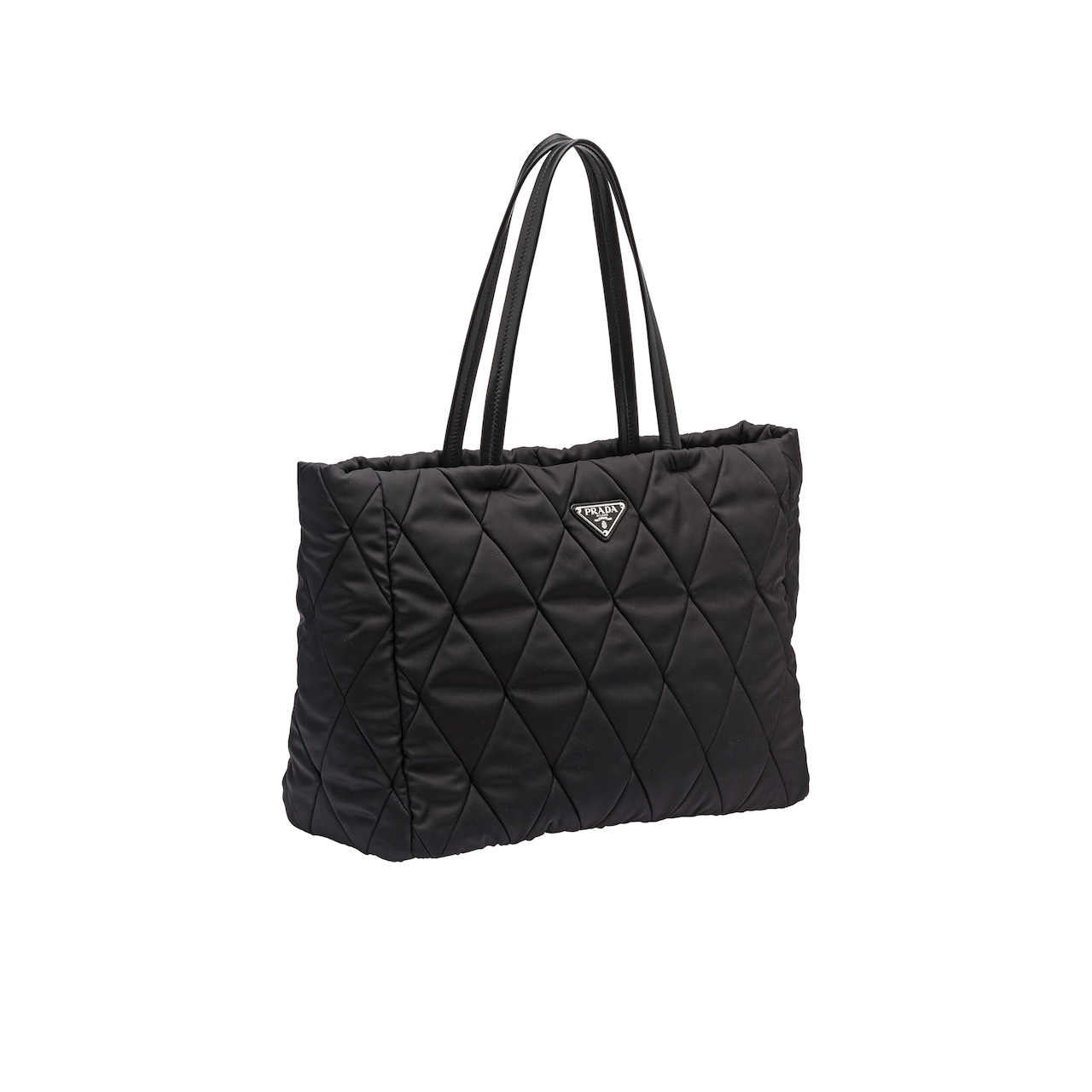 Quilting decorates this fabric tote with a sleek, clean design. The two  leather handles are long enough to wear the bag over the shoulder. 0b1abe7935