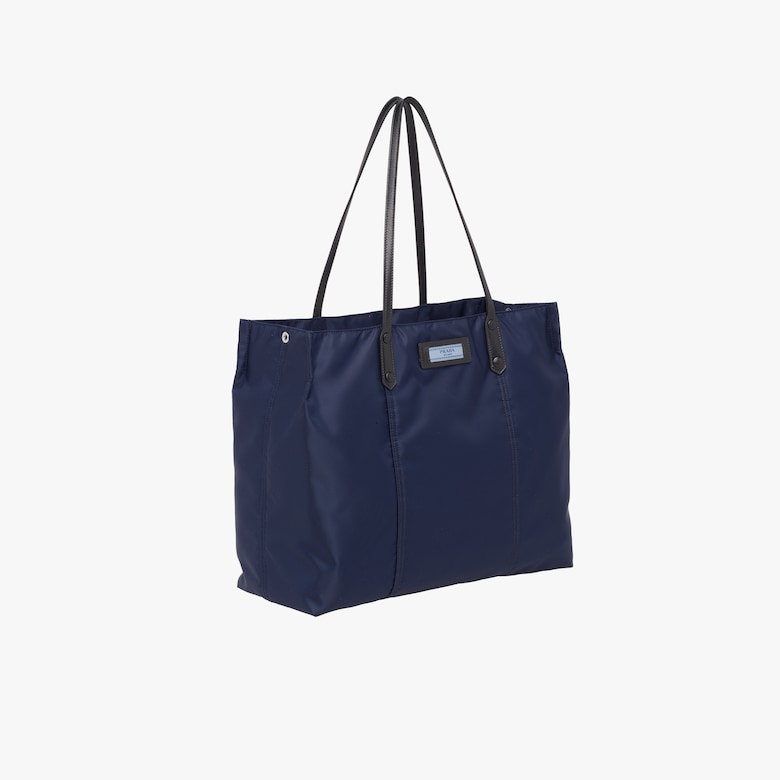 e768b81f22fa The Prada Etiquette tote stands out for its combination of iconic nylon and  fine leather trim and the distinctive light blue label.