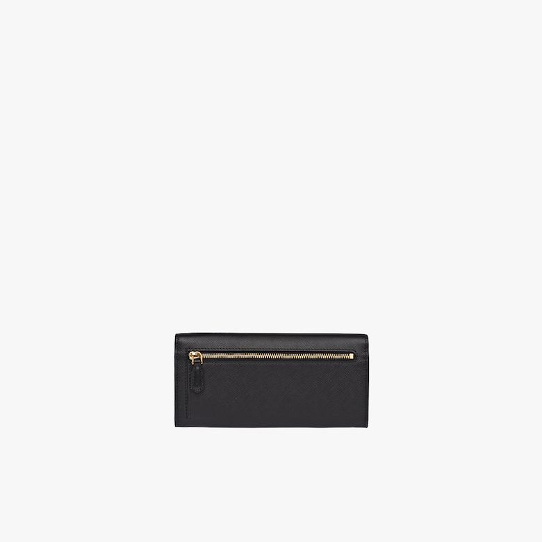 dc8011ea3061 A color-rich Saffiano leather flap wallet with metal Prada lettering in the  same tone. Opening with a snap closure, the inside contains various  compartments ...
