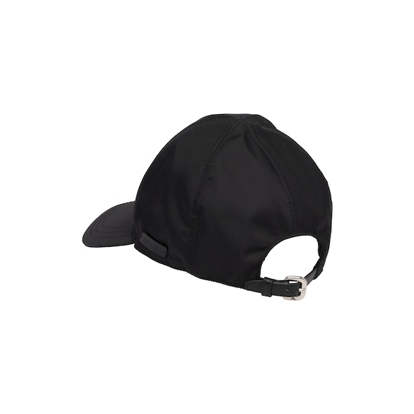 This classically shaped nylon baseball cap features a subtle Prada logo tag  on the side. The cap is adjustable thanks to the calf leather strap with  buckle ... a25a0fb0e7c