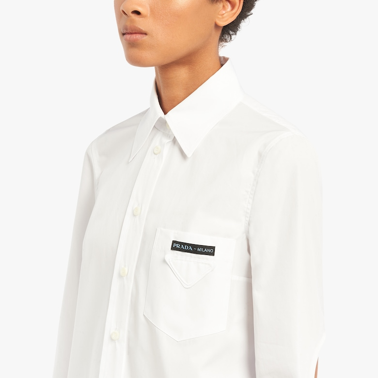 Compact poplin shirt with openings