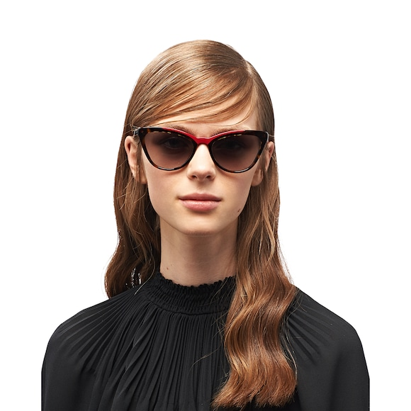 ead6c10408 Sunglasses from the Prada Ultravox collection. Feminine cat-eye silhouette  with sleek lines. Distinctive colored acetate inserts on the frame front.